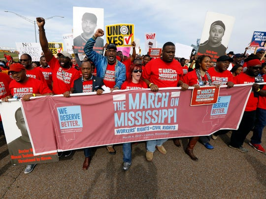 Thousands march to Nissan Motor Co.'s Canton, Miss.,