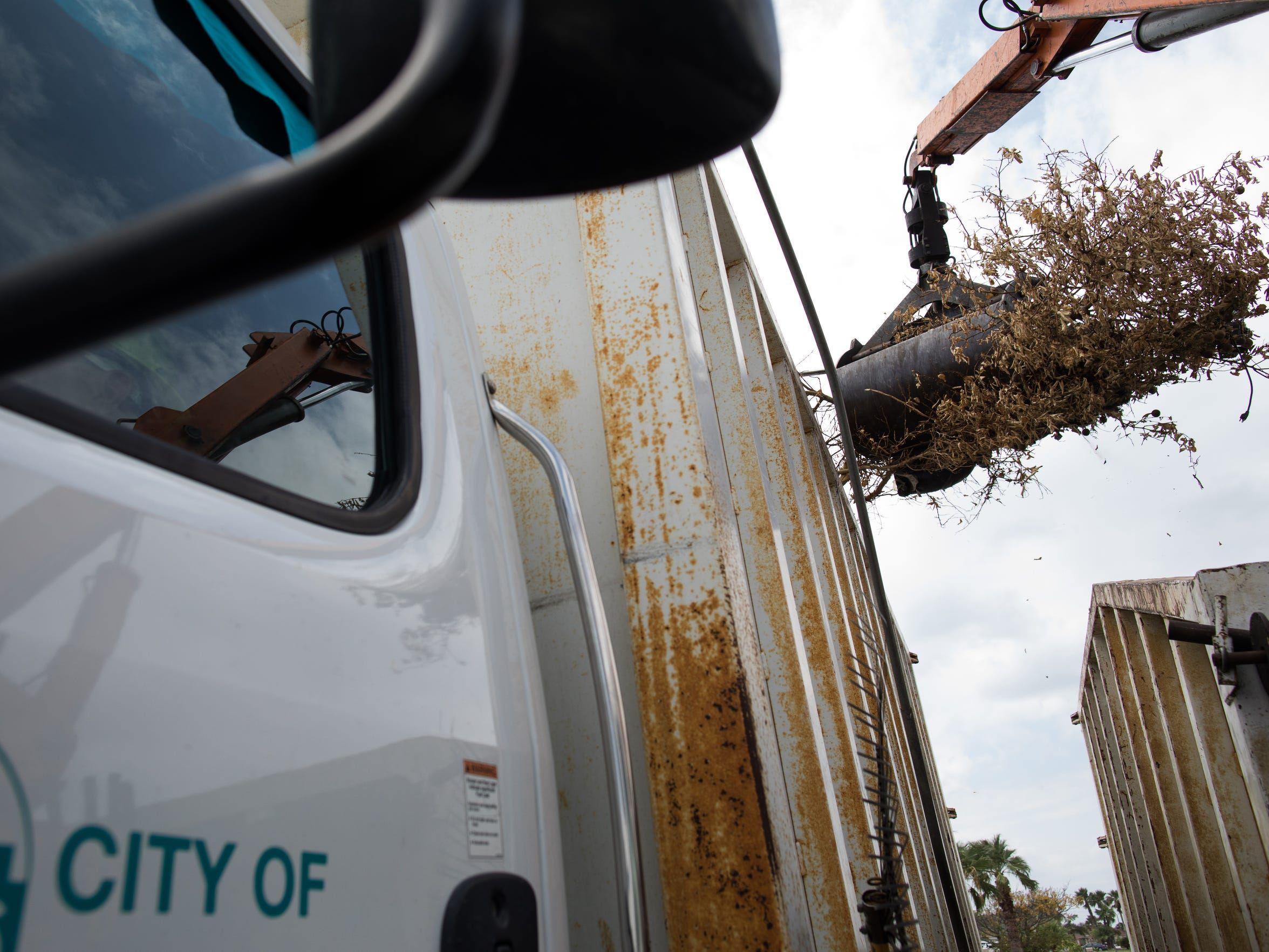 Debris from Hurricane Harvey is placed a city truck along Laffite Drive on Friday, Sept. 8, 2017.