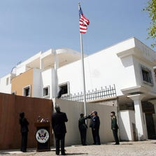 A picture taken on May 13, 2009 shows a U.S. flag fluttering outside the U.S. embassy in Tripoli.