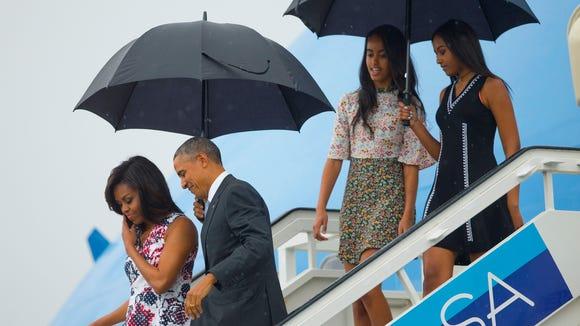 President Barack Obama, second from left, arrives with