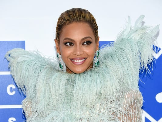 "FILE - In this Aug. 28, 2016 file photo, Beyonce arrives at the MTV Video Music Awards at Madison Square Garden, in New York. Beyonce presented Colin Kaepernick with Sports Illustrated's Muhammad Ali Legacy Award on Tuesday night, Dec. 5, 2017, and Kaepernick promised that ""with or without the NFL's platform, I will continue to work for the people."" (Photo by Evan Agostini/Invision/AP, File)"