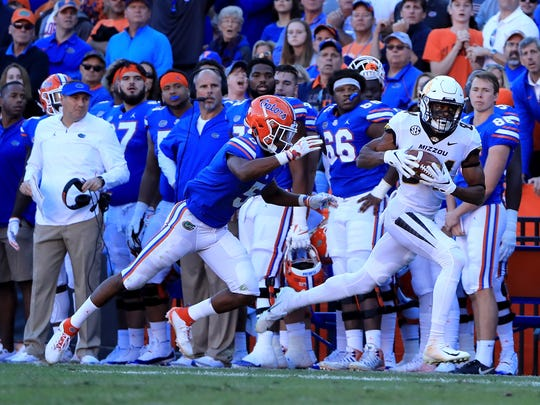 Emanuel Hall #84 of the Missouri Tigers makes a reception against CJ Henderson #5 of the Florida Gators during the game at Ben Hill Griffin Stadium on November 3, 2018 in Gainesville, Florida. (Photo by Sam Greenwood/Getty Images)