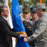 U.S. Gen. Philip Breedlove hands over the command flag to U.S. Defense Secretary Ashton Carter during a ceremony on May 3, 2016 at the Patch Barracks in Stuttgart, southern Germany. The ceremony took place at the barracks as U.S. Gen. Curtis Scaparrotti was introduced as Commander of the U.S. European Command, taking over from Breedlove.