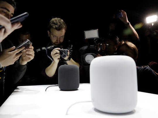 The HomePod speaker is photographed in a a showroom