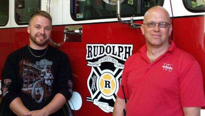 Mike Arnold, left, and Todd Dorshorst were recognized for their years of service with the Rudolph Fire Department.