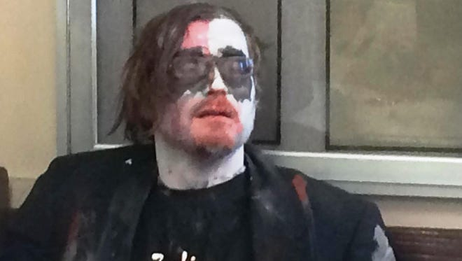 John Thomar, 28, was dressed as a zombie and using a megaphone outside the Hamilton County Courthouse on Tuesday morning
