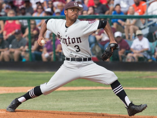 Sinton's Jordan Martinez throws a pitch in the first inning of game 3 of the Class 4A regional final series at Steve Chapman Field game against Robstown on Saturday, June 3, 2017.