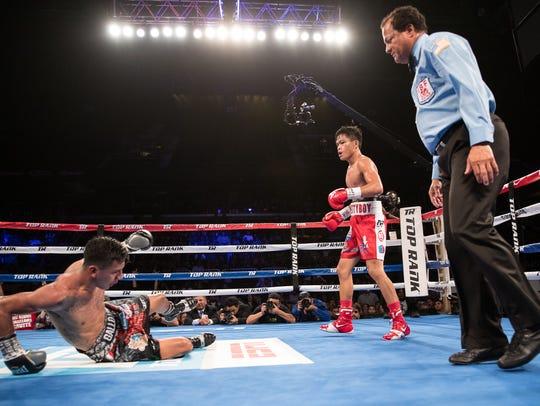 Jerwin Ancajas knocks down Israel Gonzalez as he defends