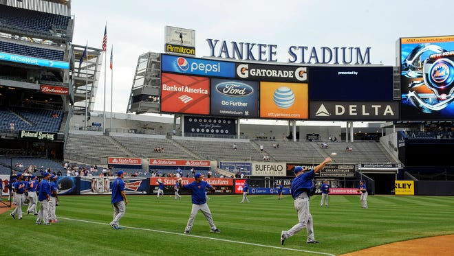 Mets players warm up at Yankee Stadium before Monday night's Subway Series opener against the Yankees.