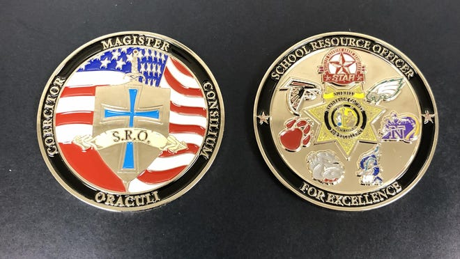 Retiring Superintendent Bo Caldwell was honored by the HCSO as one of the first civilian recipients of the department's SRO challenge coin. Maj. Frank Stout explained the challenge coin was designed by the SRO division to recognize individuals who've demonstrated outstanding support of school safety and the HCSO program.