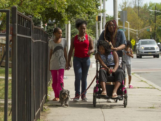 Yesenia Parker, her sisters and cousin go for a morning walk in their Jersey City neighborhood.