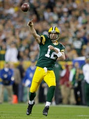 Green Bay Packers Aaron Rodgers (12) throws downfield
