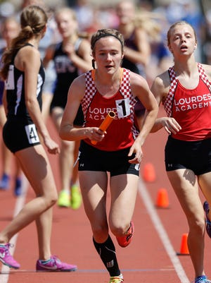 Emily Foley of Lourdes Academy finishes first in the D3 3,200-meter relay on the final day of the WIAA state track and field meet at UW-La Crosse Veterans Memorial Field Sports Complex Saturday, Jun. 3, 2017, in La Crosse.