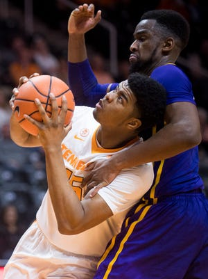 Tennessee forward Derrick Walker (15) attempts a shot during Tennessee's home basketball game against LSU at Thompson-Boling Arena on Wednesday, January 31, 2018.