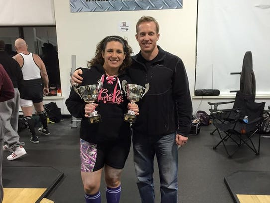 Jess Maloy, of Palmyra, stands with powerlifting coach
