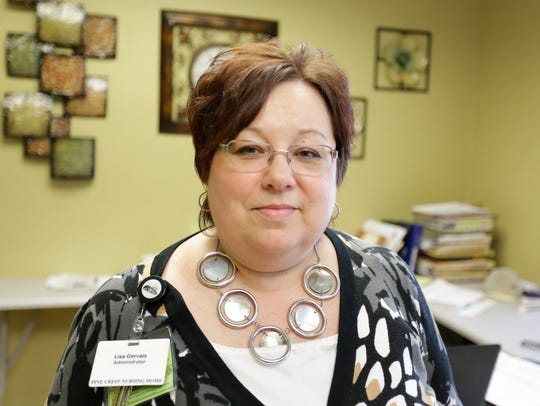 Administrator Lisa Gervais poses for a photo Friday