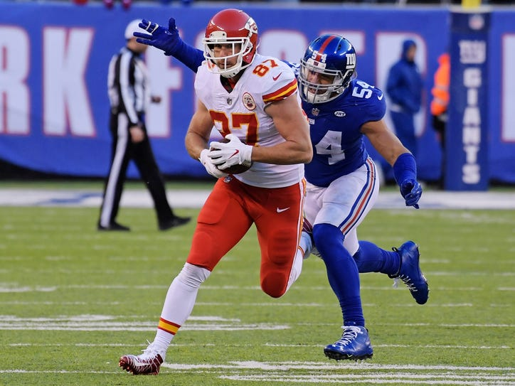 New York Giants' Olivier Vernon (54) tackles Kansas City Chiefs' Travis Kelce (87) during the second half of an NFL football game Sunday, Nov. 19, 2017, in East Rutherford, N.J. (AP Photo/Bill Kostroun)