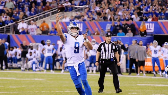 Lions quarterback Matthew Stafford lofts a pass for a 7-yard touchdown to Eric Ebron in the second quarter against the Giants, Monday, Sept. 18, 2017 in East Rutherford, N.J.