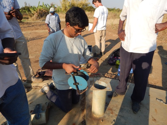 Conducting depth-to-water measurements. Pictured: Arvind Annamalai, EWB-UD Malawi Project Manager.