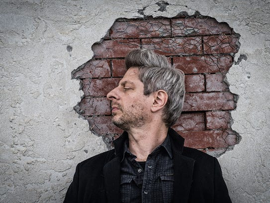 Phish bass player Mike Gordon plays a sold-out show