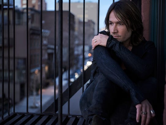 "Keith Urban co-wrote eight songs on ""Graffiti U"" and"