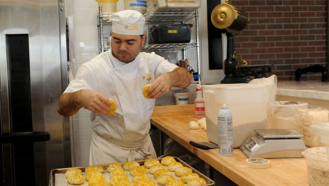 Jarrett Chambers, executive baker, makes English muffins with corn nuts at Cafe Ficelle in Ventura.