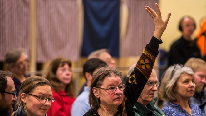 Marty Illick raises her hand to speak at Charlotte Town Meeting on Tuesday, March  7, 2017, about an amendment introduced by Mary Mead, town clerk and treasurer, to reduce the reserve fund by $100,000. Illick spoke against the amendment to removed the funds, ear marked for fire and rescue rescue, and the town voted it down minutes later.