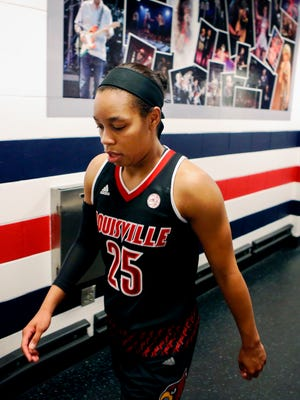 Louisville's Asia Durr walks back to the locker room after the Cards defeated Ohio State 95-90. Durr dropped a school record 47 points against the Buckeyes.