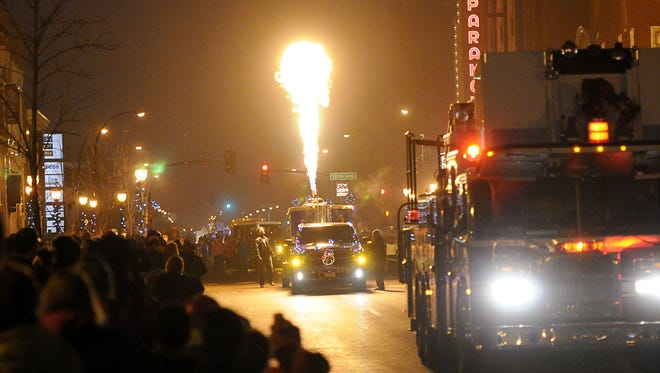 Flames from the Freedom Flight POW/MIA balloon float light the sky and warm the crowd gathered along St. Germain Street for the The Capital One 360 Winter Nights & Lights Parade in 2014.