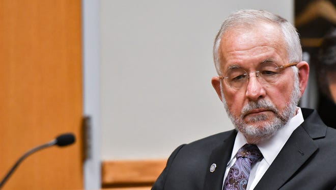 William Strampel, former dean of MSU's College of Osteopathic Medicine, listens as Eric Restuccia, chief legal counsel at the Michigan Attorney General's Office, addresses Judge Richard Ball in District Court, Thursday, May 3, 2018, during a motion hearing in East Lansing.