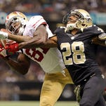 Nov 9, 2014; New Orleans, LA, USA; San Francisco 49ers wide receiver Anquan Boldin (81) catches the ball to score a touchdown as New Orleans Saints cornerback Keenan Lewis (28) defends in the second quarter at Mercedes-Benz Superdome.