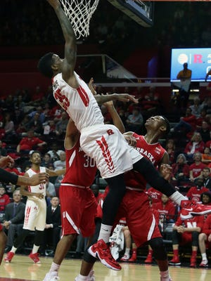 Rutgers men's basketball game vs. Nebraska,  and the halftime ceremony is honoring the 1976 Final Four team (this is the 40th anniversary year) at the RAC in Piscataway on Saturday January 9, 2015. Rutgers # 35 Greg Lewis gets past a couple of Nebraska defenders for a 1st half basket.