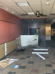 The vacant store next to Kinnelons Dunkin' Donuts, where a burglar cut a hole in the wall to steal the coffee shop's safe.