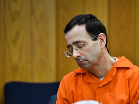 Larry Nassar hangs his head Wednesday, Jan. 31, 2018, during the first day of victim impact statements in Eaton County Circuit Court in Charlotte, Mich., where Nassar is expected to be sentenced on three counts of sexual assault some time next week.