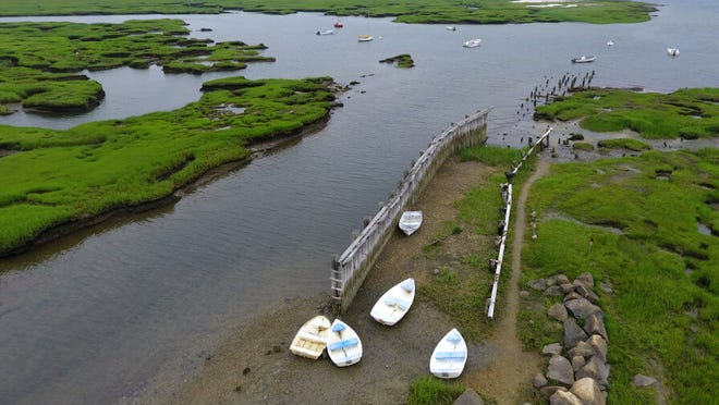 Skiffs point the way to the receding tide on Mill Creek in this aerial from the end of Wharf Lane.