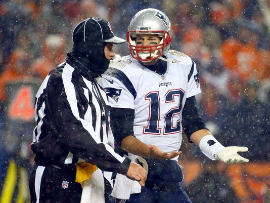 New England Patriots quarterback Tom Brady (12) argues a call with the official during the second half of an NFL football game against the Denver Broncos , Sunday, Nov. 29, 2015, in Denver. (AP Photo/Jack Dempsey)