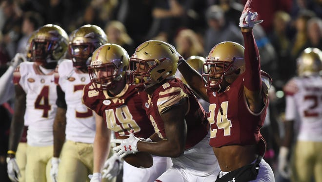Oct 27, 2017; Chestnut Hill, MA, USA; Boston College Eagles defensive back Taj-Amir Torres (24) reacts after defensive back Will Harris (8) recovered a fumble during the second half against the Florida State Seminoles at Alumni Stadium. Mandatory Credit: Bob DeChiara-USA TODAY Sports