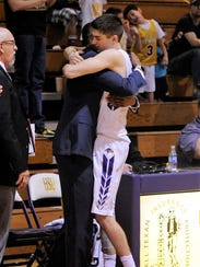 Hardin-Simmons senior Caleb Spoon (2) hugs assistant