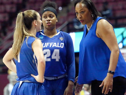 """FILE - In this March 17, 2018, file photo, Buffalo's head coach Felisha Legette-Jack, right, confers with guards Stephanie Reid, left, and Cierra Dillard during a time out while playing against South Florida in a first-round game at the NCAA women's college basketball tournament, in Tallahassee, Fla. Once her coaching career collapsed at Indiana, and Felisha Legette-Jack considered walking away from basketball entirely, she made one promise if ever another opportunity arose. Upon being hired to take over Buffalo's flagging women's basketball program in 2012, Legette-Jack vowed she was going to be her bold, brash, boisterous self rather than attempt fitting someone else's prim and boxy notion of how a coach is supposed to behave. """"Yeah, I was afraid to be me,"""" Legette-Jack told The Associated Press this week. (AP Photo/Steve Cannon, File)"""