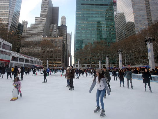 Children and adults skate in the ice rink at Bryant