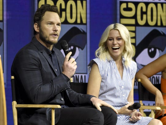 Elizabeth Banks, right, reacts as Chris Pratt speaks