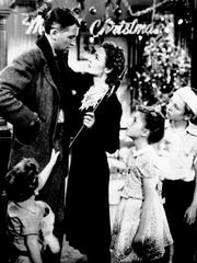 "George (James Stewart, left) and Mary Bailey (Donna Reed, center) face a tumultuous Christmas Eve in ""It's a Wonderful Life."""