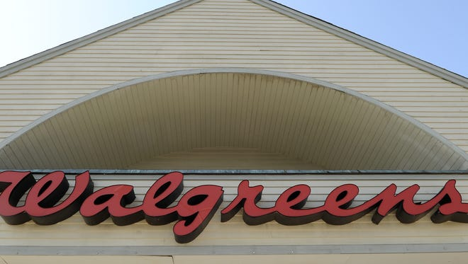 The sign above a Walgreens store. Walgreens has agreed to ensure that all customers getting prescriptions receive a pharmacist consultation as part of a $502,200 settlement with the Riverside, San Diego and Alameda county DA's offices.