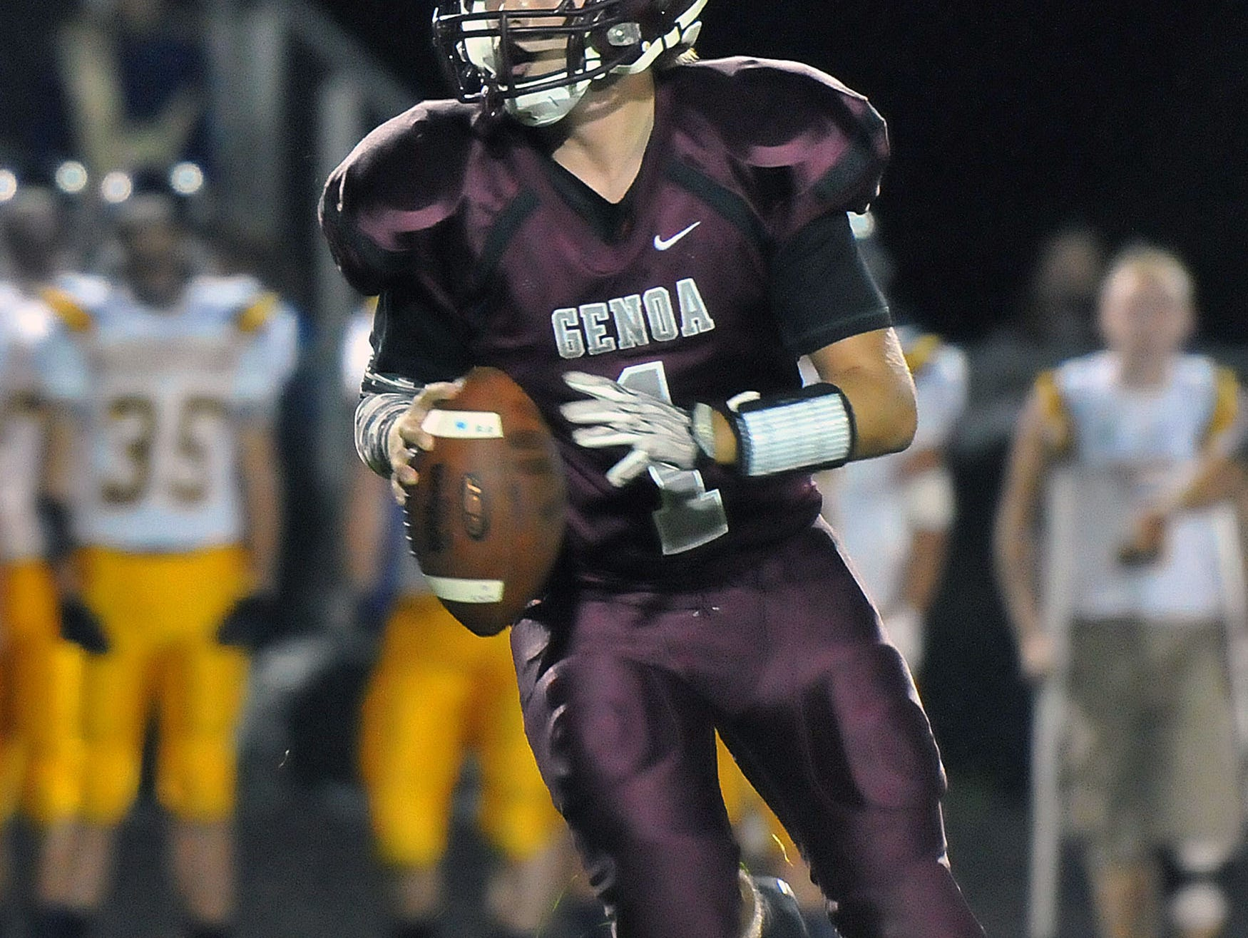 Genoa's Zach Grodi prepares to throw the ball during Friday night's game at home versus the Woodmore Wildcats.