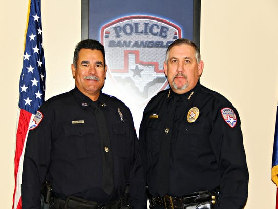 Retired Officer Jose Ruiz, left, stands with San Angelo
