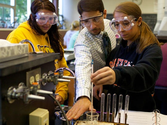 Jason D'Acchioli, a chemistry professor, works closely with University of Wisconsin-Stevens Point students on research projects and professional presentations. He was recently honored with the Excellence in Teaching, Scholarship and Service Award.