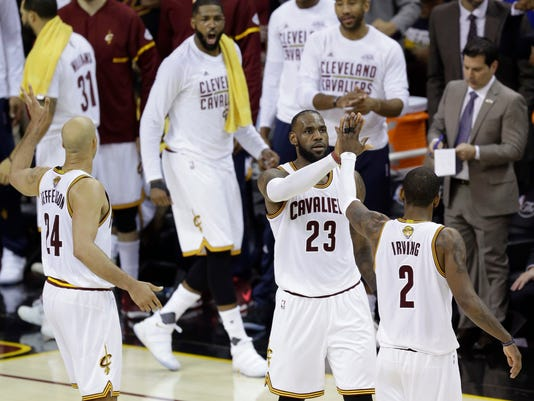 Cleveland Cavaliers forward LeBron James (23) and teammate Kyrie Irving (2) celebrate during the first half against the Golden State Warriors in Game 4 of basketball's NBA Finals in Cleveland, Friday, June 9, 2017. (AP Photo/Tony Dejak)