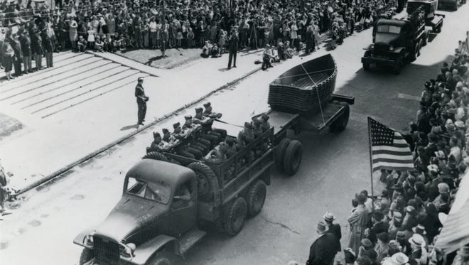 This World War II-era photo from the Newcomb Photo Collection shows a military parade in downtown Alexandria.