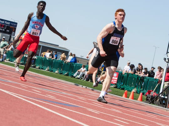 Lincoln High School Wilson Furula, left and O'Gorman High School Canyon Bauer participate in the high school boys 100 prelims during the Howard Wood Dakota Relays on Friday, May 4, 2018, at Howard Wood Field in Sioux Falls.