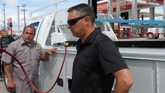 Redman Kennedy, a San Juan County employee, fills up the county's new 2016 Ford F-150 pick-up truck with compressed natural gas for the first time on Wednesday at the Bubble City Truck Stop in Farmington.
